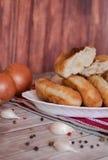 Gebratene Pastetchen mit Kartoffeln Stockfotos