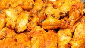 Gebratener Hühnerflügelhintergrund Lizenzfreies Stockfoto