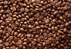 Gebratener Kaffeebohnehintergrund Stockbilder