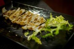 Gebratener Kalmar am japanischen Restaurant Lizenzfreies Stockbild