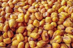 Gebratener Mais-Samenhintergrund - Beschaffenheit lizenzfreies stockfoto