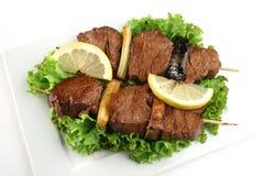 Gebratenes Fleisch auf Steuerknüppeln Lizenzfreie Stockfotos