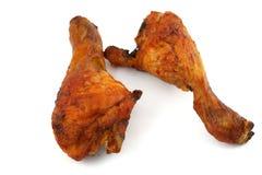 Gebratenes Hühnerbeine auf weißem Hintergrund Lizenzfreies Stockfoto