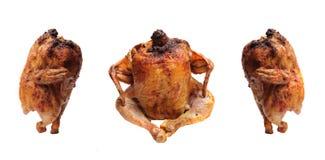 Gebratenes Huhn mit einer goldenen, knusperigen Kruste Stockfotos