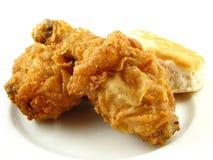 Gebratenes Huhn und Biskuit Stockbilder