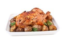 Gebratenes Huhn und Kartoffeln Stockbilder