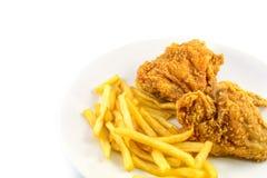 Gebratenes Huhn und Pommes-Frites Stockfotos