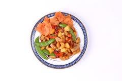 Gebratenes Mischobst und gemüse mit gebratener Paprikaplatte Stockbild