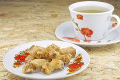 Gebratenes Schweinefleisch mit Tee Lizenzfreie Stockfotos
