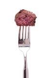Gebratenes Straußfleisch auf einer Gabel Lizenzfreie Stockfotografie