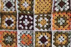 Gebreide achtergrond, kleurenvierkanten Royalty-vrije Stock Foto