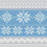 Gebreide de winterachtergrond met sneeuwvlokken Royalty-vrije Stock Afbeeldingen