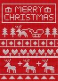 Gebreide Kerstmis op rood ontwerp als achtergrond Stock Foto's
