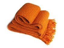 Gebreide oranje sjaal Stock Afbeelding