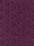 Gebreide stof met een patroon van verticale vlechten Royalty-vrije Stock Afbeelding
