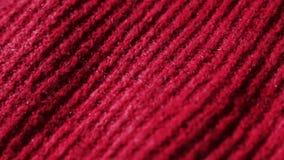 Gebreide stof in redcolor Kan als achtergrond worden gebruikt stock videobeelden