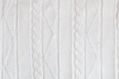 Gebreide witte patroonstof De winter textielachtergrond royalty-vrije stock afbeelding