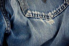 Gebrekkig jeansdenim als achtergrond met een naad van uitstekende het denimtextuur van het manierontwerp royalty-vrije stock foto's