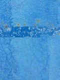 Gebrochene blaue Farbenwand der Beschaffenheit Lizenzfreie Stockfotografie