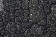 Gebrochene dunkle Beschaffenheit mit Sandkörnern Lizenzfreies Stockbild