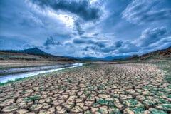 Gebrochene Erde in der Dürren-Jahreszeit Lizenzfreie Stockfotos