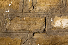 Gebrochene Sandstein-Wand-Hintergrundbeschaffenheit Stockfotos