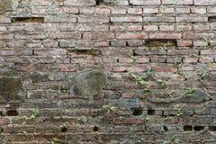 Gebrochener konkreter Weinlese-Backsteinmauerhintergrund Stockfoto