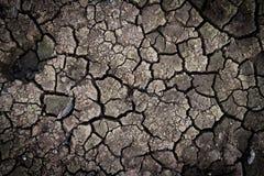 Gebrochener Lehm rieb in die Trockenzeit Stockfoto
