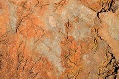 Gebrochener roter Felsen für Hintergrund Lizenzfreie Stockfotos