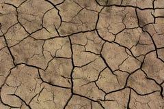 Gebrochener trockener Boden Stockbilder