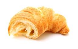Gebroken croissant die op wit wordt geïsoleerd Stock Foto's