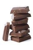 Gebroken geïsoleerdee stukken van chocolade Royalty-vrije Stock Afbeelding