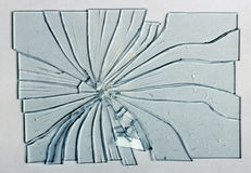 Gebroken glas op een grijze achtergrond Stock Fotografie