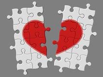 Gebroken mozaïek van raadsels met symbool van hart Royalty-vrije Stock Foto's