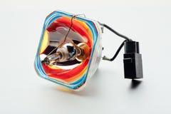 Gebroken projectorlamp, witte achtergrond Stock Fotografie