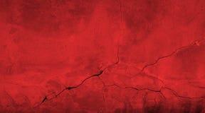 Gebroken rode van de steenmuur textuur als achtergrond met barsten stock foto