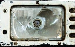 Gebroken tractorkoplamp Stock Foto