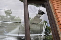 Gebroken venster glasse Stock Foto's