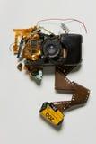 Gebroken verouderde filmcamera royalty-vrije stock afbeeldingen