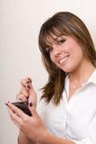 Gebruikend handbediend met een glimlach - BedrijfsReeks Royalty-vrije Stock Fotografie
