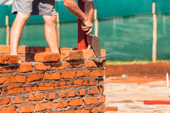 Gebäude-Handwerker-Maurerarbeit Stockbild