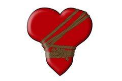 Gebundenes Herz mit Seil auf weißem Hintergrund Stockfotos