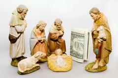 Geburt Christi GEGEN Geschäftsgeisten stockbild