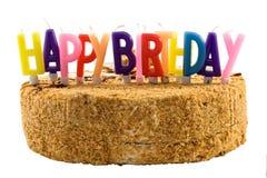 Geburtstagkuchen mit Farbenkerzen Lizenzfreies Stockfoto