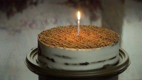 Geburtstagskuchen mit Kerze Stockbild