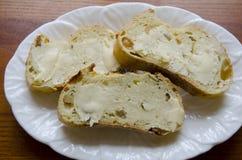 Gebuttertes Brot Stockbild