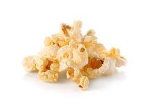 Gebuttertes Popcorn lokalisiert auf weißem Hintergrund Stockfotografie