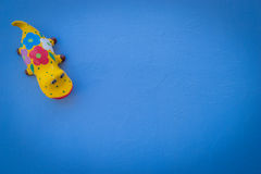 Gecko Doll Model blue background. Royalty Free Stock Images