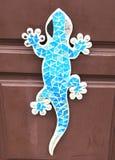 Gecko on the door. Blue gecko on the door Stock Photo