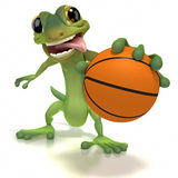 Gecko holding basketball Royalty Free Stock Images